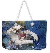 An Astronaut Is Submerged In The Water Weekender Tote Bag by Stocktrek Images
