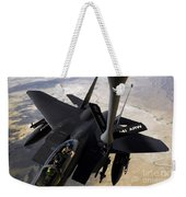 An F-15e Strike Eagle Aircraft Receives Weekender Tote Bag by Stocktrek Images