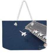 An Fa-18 Hornet Flys Over Aircraft Weekender Tote Bag by Stocktrek Images
