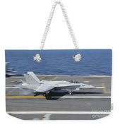 An Fa-18c Hornet Lands Aboard Uss Weekender Tote Bag