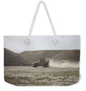 An M-atv Races Across The Wadi Weekender Tote Bag