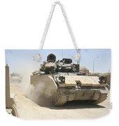 An M2 Bradley Fighting Vehicle Patrols Weekender Tote Bag