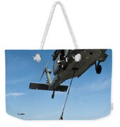 An Mh-60s Sea Hawk Helicopter Lowers Weekender Tote Bag