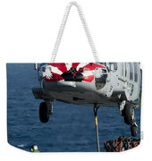 An Mh-60s Sea Hawk Picks Up Pallets Weekender Tote Bag