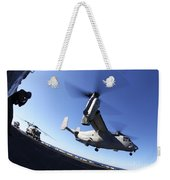 An Mv-22 Osprey Lands Aboard The Uss Weekender Tote Bag