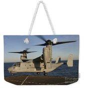 An Mv-22 Osprey Lands Aboard Usns Weekender Tote Bag