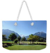 An Open Field In Interlaken With A View Of The Mountains In The Background Weekender Tote Bag