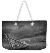 Boat Stranded On A Beach Covered By Menacing Storm Clouds Weekender Tote Bag