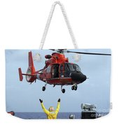 Boatswain Mate Directs A Hh-65a Dolphin Weekender Tote Bag by Stocktrek Images