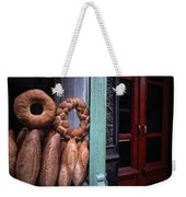 Bread Is Displayed In A Store Window Weekender Tote Bag