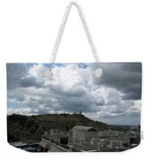 Buildings Cover The Lower Section Of A Hill That Has A Temple At The Top With Clouds Covering The Sk Weekender Tote Bag