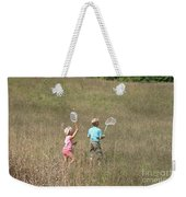 Children Collecting Insects Weekender Tote Bag by Ted Kinsman