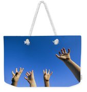Childrens Hands Reach Toward The Blue Weekender Tote Bag