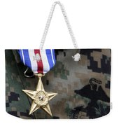 Close-up Of A Medal On The Uniform Weekender Tote Bag