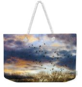 Cloudy Sunset With Bare Trees And Birds Flying Weekender Tote Bag