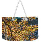 Colorful Fall Leaves Over Blue Water Weekender Tote Bag