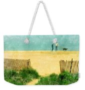 Couple Walking Dog On Beach Weekender Tote Bag by Jill Battaglia
