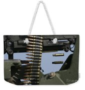 Expended Brass Falls From A Machine Gun Weekender Tote Bag
