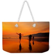 Family Running In The Beach At Sunset Weekender Tote Bag