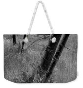 Fence Posts And Barbed Wire At The Edge Of A Field In Montana Weekender Tote Bag