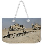 Firearms Sit Ready On A Firing Range Weekender Tote Bag