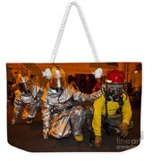 Firemen Brace For Shock Weekender Tote Bag by Stocktrek Images