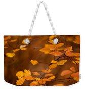 Floating On Orange Fall Leaves Weekender Tote Bag