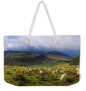 Flock Of Sheep Grazing In A Field Weekender Tote Bag