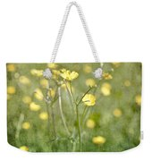 Flower Of A Buttercup In A Sea Of Yellow Flowers Weekender Tote Bag