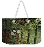 Flowers Bloom From An Unlikely Place-a Weekender Tote Bag