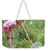 Girl Collects Insects In A Meadow Weekender Tote Bag by Ted Kinsman