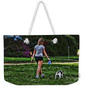 Girl Walking Dog Weekender Tote Bag by Paul Ward