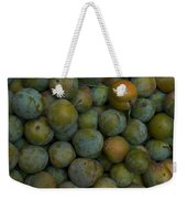 Green Plums Fill A Bin Outside A Local Weekender Tote Bag
