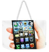 Hand Holding An Iphone Weekender Tote Bag by Photo Researchers