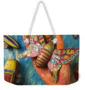 Hand Holding Butterfly Toy Weekender Tote Bag