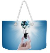 Hand Holding Light Bulb With Globe  Weekender Tote Bag