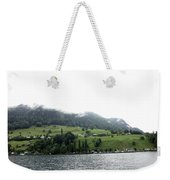Houses On The Greenery Of The Slope Of A Mountain Next To Lake Lucerne Weekender Tote Bag