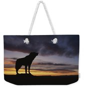 Howling Wolf Silhouetted Against Sunset Weekender Tote Bag