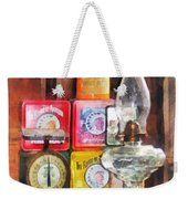 Hurricane Lamp And Scale Weekender Tote Bag by Susan Savad