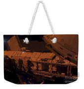 In The Darkness Of Space, An Astronaut Weekender Tote Bag by Stocktrek Images