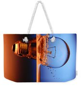 Light Bulb Shot Into Water Weekender Tote Bag by Setsiri Silapasuwanchai