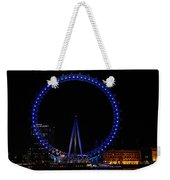 London Eye All Done Up In Blue Light In The Night With A Small Reflection In The Thames Weekender Tote Bag