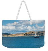 Luxury Yacht Sails In Blue Waters Along A Summer Coast Line Weekender Tote Bag