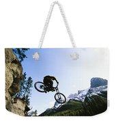 Man Jumping On His Mountain Bike Weekender Tote Bag