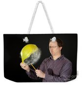 Man Popping A Balloon Weekender Tote Bag