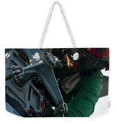 Mechanic Inspects An Mh-60r Sea Hawk Weekender Tote Bag by Stocktrek Images