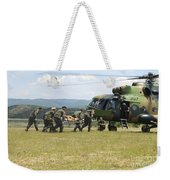 Medical Personnel Carry A Wounded Weekender Tote Bag