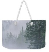 Mist Rises From An Evergreen Forest Weekender Tote Bag