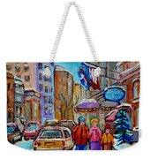 Montreal Street Scenes In Winter Weekender Tote Bag by Carole Spandau