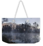 Mountain And Trees Reflected In A Foggy Lake Weekender Tote Bag